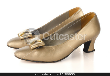 Gold high-heeled shoes stock photo, Gold high-heeled shoes isolated on white background. by Homydesign