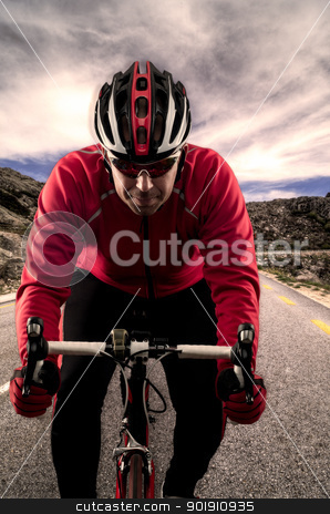 Cyclist on the road stock photo, Cyclist on road bike through a asphalt road in the mountains and blue sky with clouds. by Homydesign