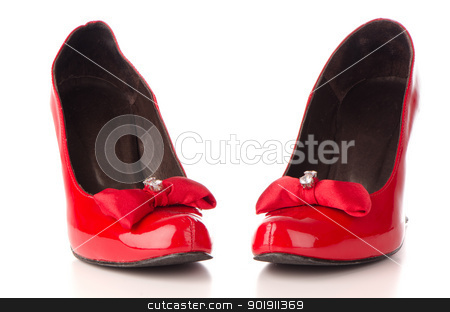 Red shoes stock photo, Red shoes isolated on white reflective background. by Homydesign