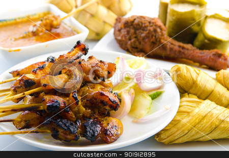 Satay chicken stock photo, Delicious Asian Malay cuisine over white background by szefei