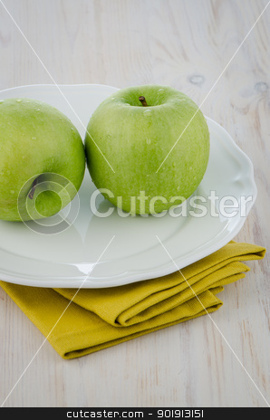 Two green apples stock photo, Two green apples on the white plate pm white wooden table. by Homydesign
