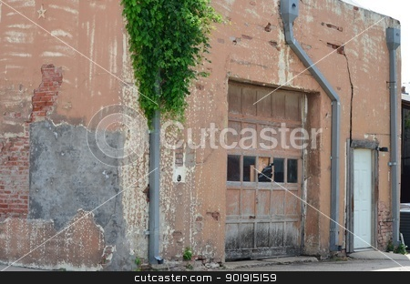 Weathered building in Prosper Texas stock photo, Exterior of old garage with lots of different textures and colors. by Ltisha