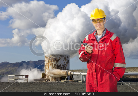 Renewable energy engineering stock photo, Engineer with cb radio standing next to the violently emitting tube of a geothermical energy plant by Corepics VOF