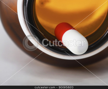 Pills stock photo, close up of the pill and bottle by eskaylim