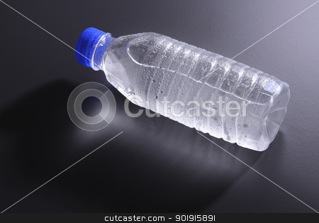 water bottle stock photo, mineral water bottle on the dark background by eskaylim