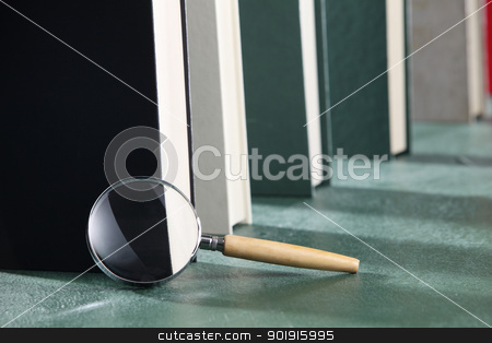 searching stock photo, MagnMagnifying glass next to book by eskaylim