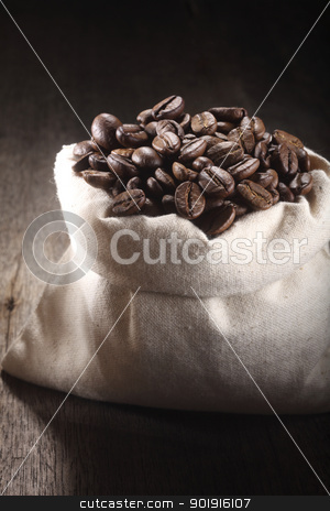 roasted  coffee bean stock photo, Close-up of coffee beans in a sack by eskaylim