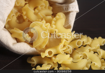 pasta  stock photo, pasta pouring from the sack by eskaylim