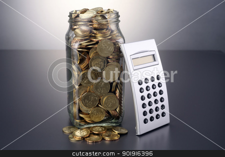 home finance stock photo, coins in the container and calculator by side by eskaylim