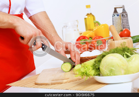Fresh cut vegetables stock photo, Fresh vegetables being cut with a knife by Sergey Nivens