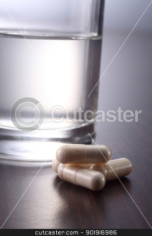 medicine and water stock photo, medicine and a glass of water by eskaylim