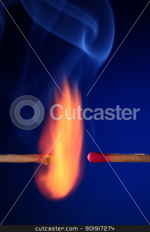 lit matchstick next to an unlit matchstick stock photo,  burning and unlit match on the blue background by eskaylim