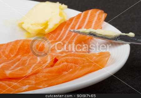 Salmon stock photo, A piece of salmon over a white plate, with butter by Fabio Alcini