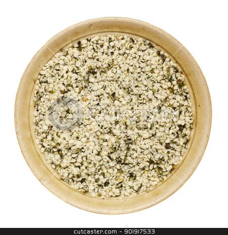 shelled hemp seeds  stock photo, shelled hemp seeds in a round ceramic bowl isolated on white by Marek Uliasz