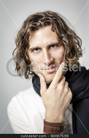curly hairdo stock photo, An image of a handsome man with a curly hairdo by Markus Gann