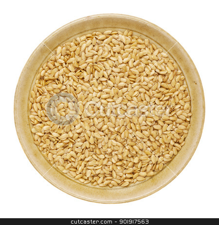 gold flax seeds stock photo, gold flax seeds in a round ceramic bowl isolated on white by Marek Uliasz