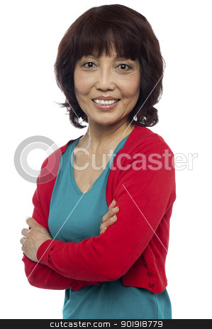 Asian woman posing with her arms crossed stock photo, Asian woman posing with her arms crossed isolated against white background by Ishay Botbol