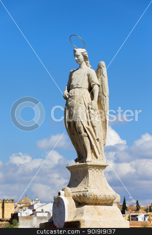 Archangel Raphael Statue in Cordoba stock photo, Archangel Raphael statue from 1651 by Bernabe Gomez del Rio on the Roman Bridge in Cordoba, Spain. by Rognar