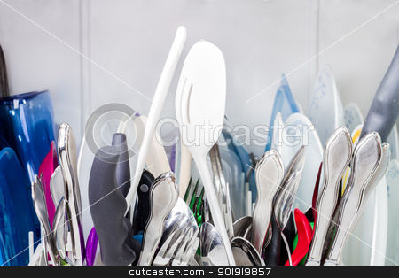 Close up view of the top of the dishes stock photo, Gathering of dishes in the silverware rack.  by txking