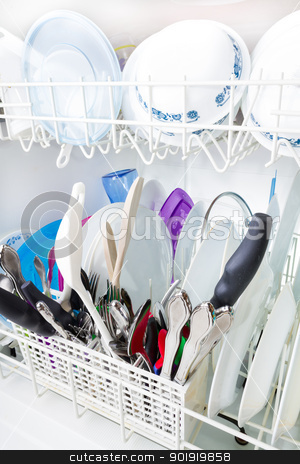Sparkling clean dishes in the dishwasher stock photo, Downward looking view of dishes that are nice and clean. by txking