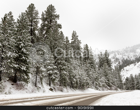Road going through the mountains stock photo, Cold day up in the mountains with a road that people have gone over. Scene is covered in snow. by txking