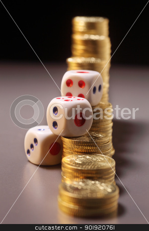 gamble stock photo, dices rest on top of the coins by eskaylim