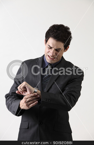 rushing stock photo, Close-up of a businessman checking the time by eskaylim