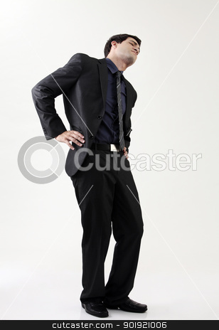 back pain stock photo, full length of Man Suffering Back Pain by eskaylim