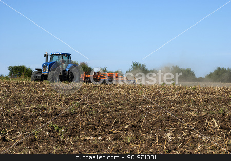 Fall field harrowing landscape stock photo, Fall landscape field harrowing with tractor and harrow  by Aleksandar Varbenov