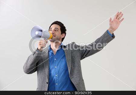 shouting stock photo, Businessman shouting through megaphone by eskaylim