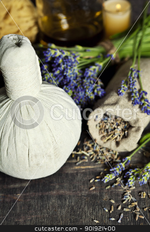 lavender spa stock photo, Fresh and dried lavender flowers, essential oil, soap and Herbal massage balls over wooden surface by klenova