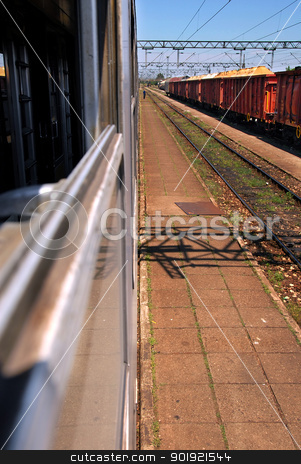 Trains on railroad stock photo, railway with passenger and cargo trains through the window by Julija Sapic