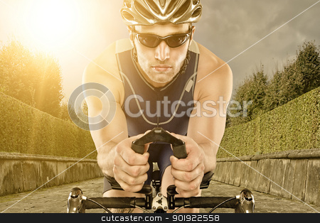 Biker stock photo, Young man with bike in sunset by Picturehunter