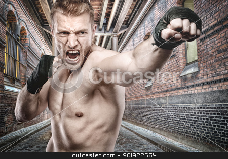 Boxing stock photo, Young boxer in front of urban style by Picturehunter