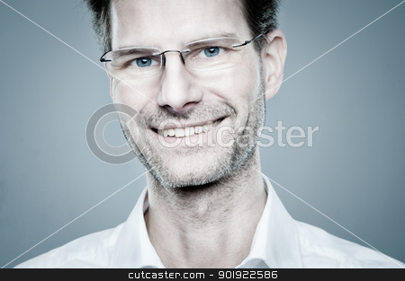 Smiling man stock photo, Portrait from a happy and smiling man by Picturehunter
