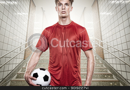 Soccer player stock photo, Young soccer player in gray tunnel by Picturehunter