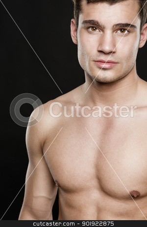 Attractive young man  stock photo, Attractive young man in front of black background  by Picturehunter