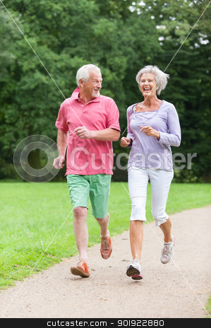 Active seniors stock photo, Active senior couple in the park by Picturehunter