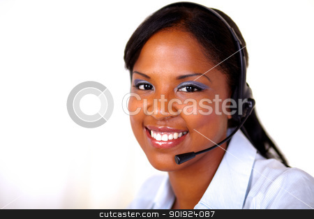 Afro-american receptionist looking at you stock photo, Afro-american receptionist looking at you with headphones - copyspace by pablocalvog