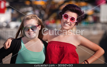 Two Teen Girls Outside stock photo, Two white and Hispanic best friends at an amusement park by Scott Griessel