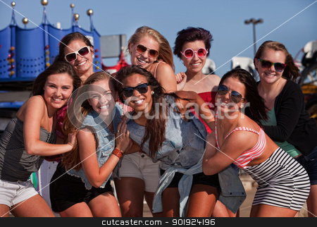 Happy Best Friends Outside stock photo, Happy group of eight teenage girls together at a theme park by Scott Griessel