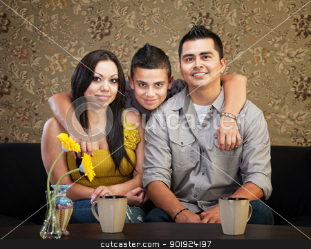 Happy Hispanic Family stock photo, Young smiling Latino family sitting indoors together by Scott Griessel