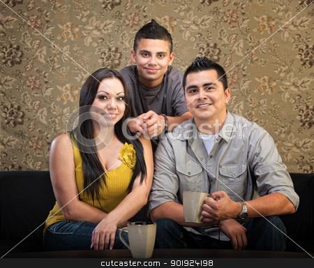 Loving Hispanic Family stock photo, Loving Latino family of three sitting together by Scott Griessel