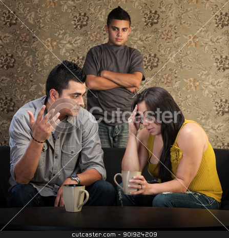 Worried Parents With Angry Son stock photo, Worried Native American couple with upset son indoors by Scott Griessel