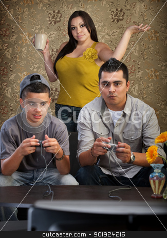 Hopeless Mom with Gamers stock photo, Hopeless mother behind father and son playing video games by Scott Griessel