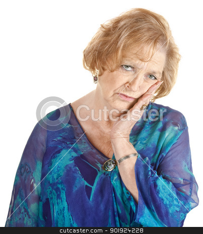 Tired Older Woman stock photo, Tired older woman in blue with hand on cheek by Scott Griessel