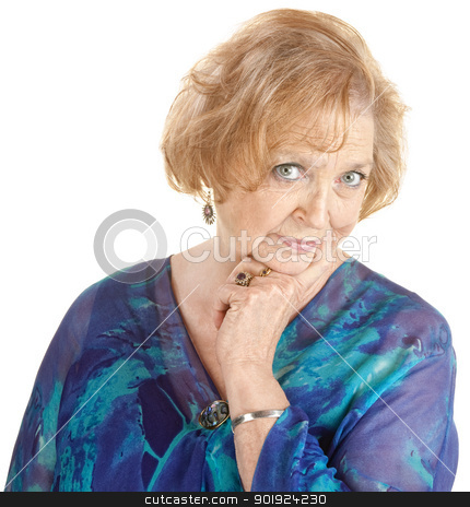 Curious Mature Woman stock photo, Curious mature woman with finger on cheek over white background by Scott Griessel