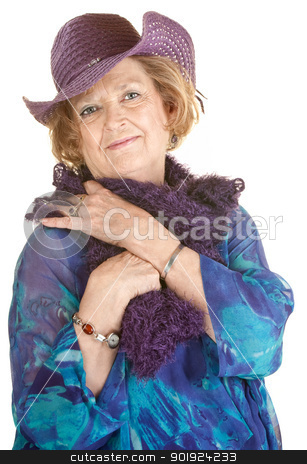 Cute Older Woman in Purple Hat stock photo, Fashionable mature woman in purple boa and cowboy hat by Scott Griessel