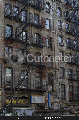 Fire escape stock photo, Fire escapes run diagonally down colorful apartment buildings  by Yann Poirier