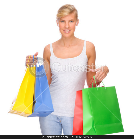 Shopping time stock photo, Full isolated portrait of a beautiful  woman with shopping bags by Picturehunter